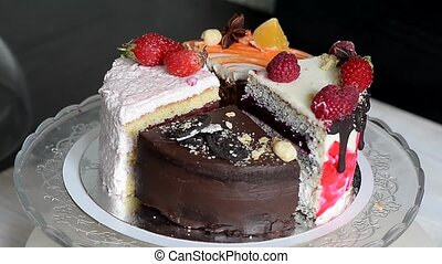 The different pieces of the cake smoothly rotate on the...