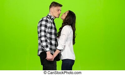 Lovers meet, join hands and spin, kiss, hug. Green screen -...