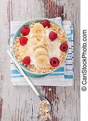 Musli with fresh yogurt with raspberries - Oatmeal with...