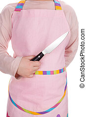 Young girl holding kitchen knife. - Young girl chef in pink...
