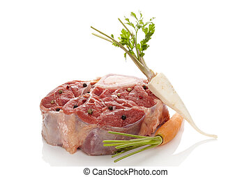Raw veal shank meat with vegetables. - Raw veal shank meat...