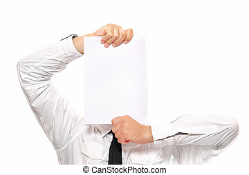 Businessman holding white paper - A close-up of a...