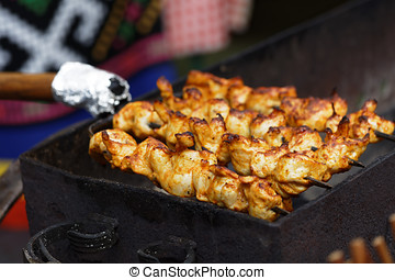 Roasting Frigarui on an outdoors grill