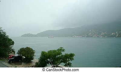 A ferry in the Boka Bay of Kotor in Montenegro, from...