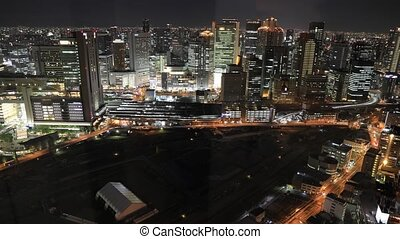 Osaka nightscape aerial - Aerial view time lapse of Osaka...