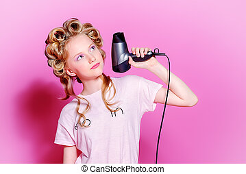 curling blonde hair - Portrait of a pretty girl teenager...