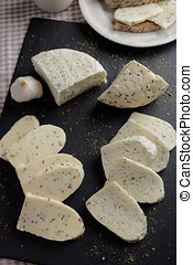 Estonian cheeses with cumin, dill, and garlic on a slate...