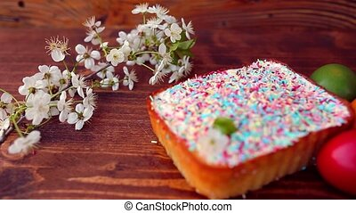 Easter cake on a plate, on a wooden board.