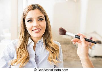Satisfied customer in a beauty salon