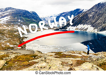 Tourist taking photo by Djupvatnet lake, Norway - Tourism...
