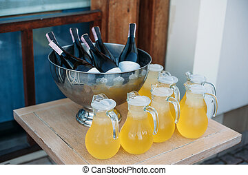 Bottles of wine in an ice bowl