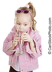 Child drinks water - The small girl is drincking water from...