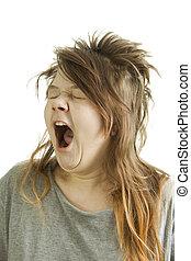 Sleepy girl yawning - Sleepy and shaggy girl yawning.