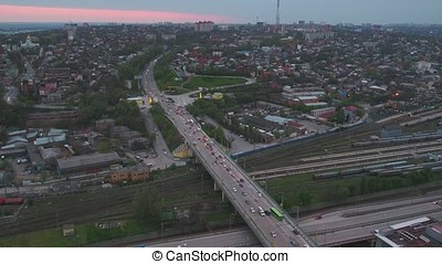 Aerial view of a massive highway intersection in Moscow. View from the sky on City landscape at night. Evening traffic aerial