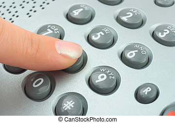 Phone keypad and woman finger