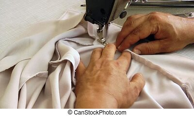 Tailor video when he is working