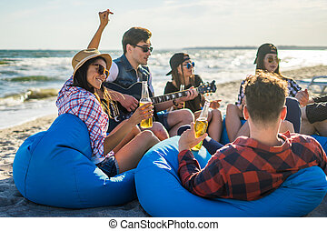 group of friends drinking on the beach party