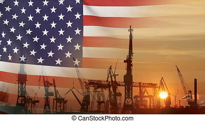 Industrial concept with USA flag at sunset, silhouette of...