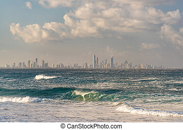 Ocean with waves and Gold Coast cityscape on the background...