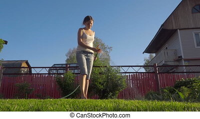 Woman watering the lawn