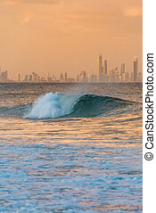 Beautiful big wave with iconic Gold Coast skyscrapers on the...