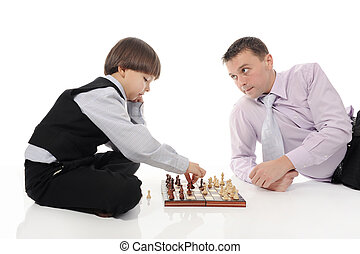 Dad and son playing chessin a bright room Isolated on white...