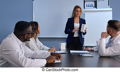 Young businesswoman presenting new tablets or pills to...