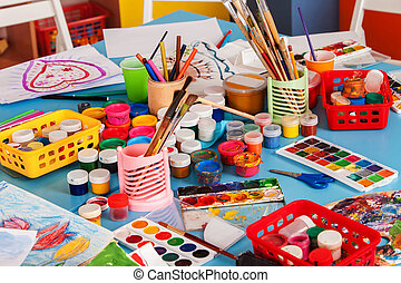 Kindergarten tables and chairs in interior decoration shelves for toys.