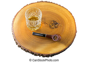 Glass of single malt scotch whisky, aromatic pipe tobacco on...