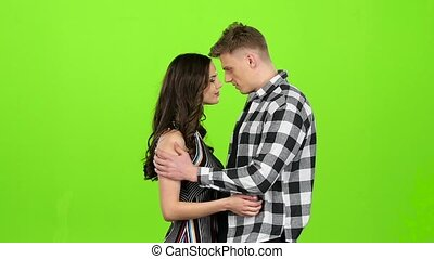 Lovers meet, join hands and spin, kiss, hug. Green screen....