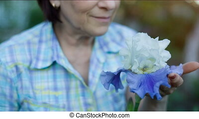 Middle Aged Woman Smelling Flower - beautiful middle aged...
