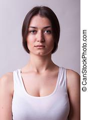 Portrait of beautiful woman wearing a white shirt. Sexy...
