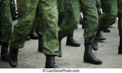 soldiers marching by the street - soldiers marching training...