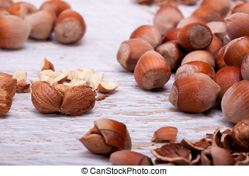 Healthy Hazelnuts on white wooden background in studio...