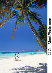 Couple walking on beach, Mauritius Island - Couple walking...