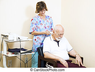 Chiropractic Ultrasound Therapy - Chiropractic nurse treats...