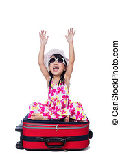 Happy Asian Little Chinese girl sitting on a suitcase in...