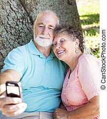 Seniors Say Cheese - Senior couple taking their...