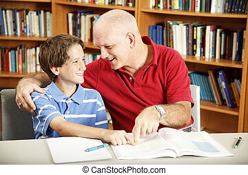 Homework Help from Dad - Cute school boy gets help with his...