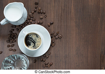 Cup of coffee on the wooden table - Cup of coffee, cream in...