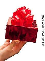 Female hand holding present - Female hand giving a christmas...