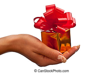 Gold gift box in womans hand - Womans hand with a small gold...