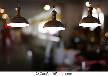 Vintage lamps in a restaurant. - Vintage lamps in a...
