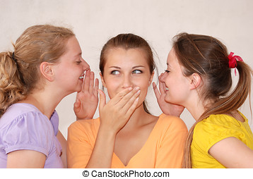 Gossip - Friends telling secrets over white background