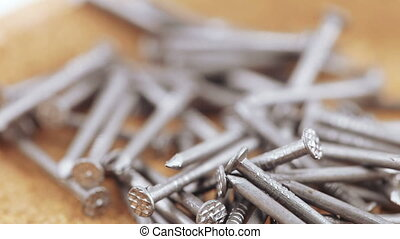 Iron nails on the cork surface - Metal nails staples for...
