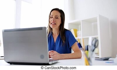happy woman with laptop having video conference - business,...