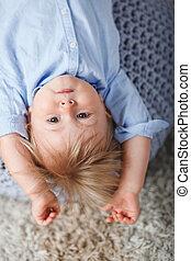 upside down boy on pouf