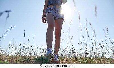 travel. Girl in summer in the field travels on nature grass. woman sunlight