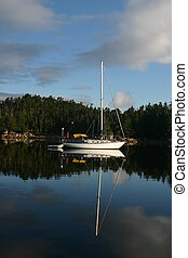 Sail boat on West coast of BC Canad - Sail boat anchored in...