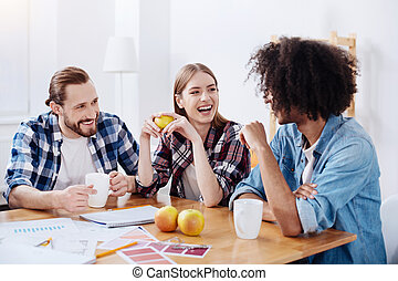 Emotional cute people laughing at colleagues joke - Witty...
